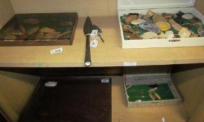 A bronze arrow head, the blades inscribed,