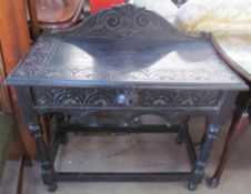 A 19th century ebonised low countries side table with a single drawer and lions mask handle on