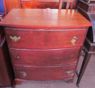 A mahogany chest of drawers with three long drawers on bracket feet