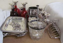 A pair of cranberry glass and electroplated decanters together with a brown glass example,