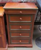 A Modern bedside chest with a frieze drawer and four other graduated drawers