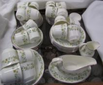 A Royal Doulton Ainsdale pattern H5038 part tea and coffee set together with a Beswick foal