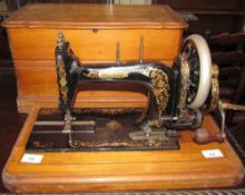 A cased Bradbury sewing machine