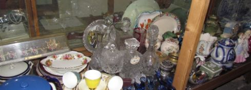 A large lot including decanters, and a Royal State Coach model, together with assorted plates,