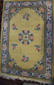 A Chinese rug, yellow field with central medallion in ivory foliate main border,