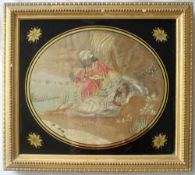 A George III silkwork picture of oval form depicting a figure in a turban and a reclining maiden