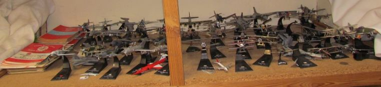 A collection of model aeroplanes together with assorted Rugby programmes