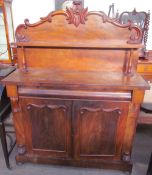 A Victorian mahogany chiffonier with a raised superstructure and shelf,