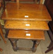 A nest of three oak tables