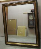 A large gilt decorated wall mirror