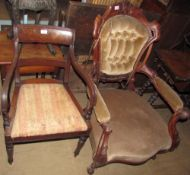 A Victorian walnut framed library chair with a button back upholstered back,