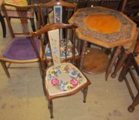 A carved occasional table together with a pair of bedroom chairs and a salon chair