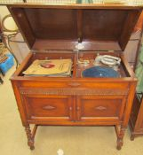 A Gilbert oak cased gramophone together with a collection of 78 records