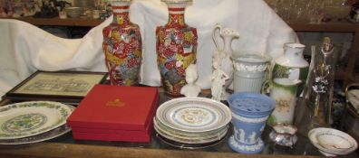 A pair of Japanese satsuma pottery vases together with collectors plates, porcelain music box,