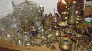 Assorted brasswares including candlesticks, vases, etc together with glass vases,