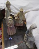 A Lladro figure of a lady holding lilies together with a recollections of wales figurine,