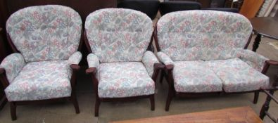 A modern three piece suite with a wooden frame