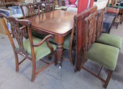 A Victorian mahogany extending dining table with rounded corners on tapering reeded legs,