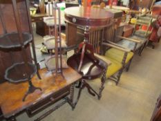 A Victorian walnut games table together with two folding cake stands,