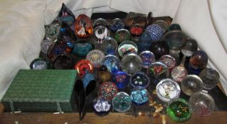 A collection of Caithness and other glass paperweights together with vases etc