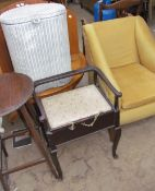 A piano stool together with an upholstered chair,