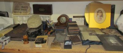 An inlaid mantle clock together with a lacquered tin wig box and wig, photographs, drinking glasses,