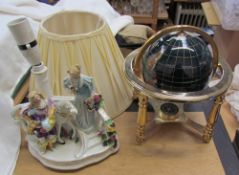 A gem set globe together with a pottery table lamp