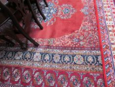 A room size rug with an orange ground,