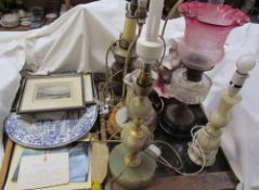A Victorian oil lamp with a clear glass reservoir and graded shade together with table lamps,