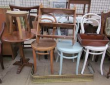 Three bentwood dining chairs together with a rug, hanging shelves, stool,