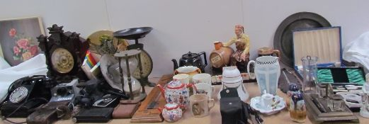 A mantle clock together with Salter scales, cameras, assorted ceramics barometer, timer, standish,