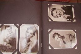 "A postcard album, ""My Film Favourites"" including Fred Astaire, Ginger Rogers, Jean Rogers,"