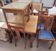 A 20th century oak extending dining table together with four chairs and a pair of bergère bedside