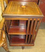 An Edwardian mahogany revolving bookcase,