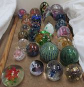 A collection of paperweights including Mdina, Caithness, Kerry Glass,