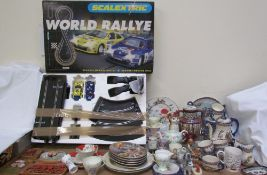 A Scalextric World Rally set together with collectors plates, Welsh pottery plaques,