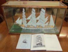 A model ship in a glass case,