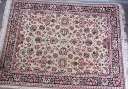 A floral decorated rug with a cream ground