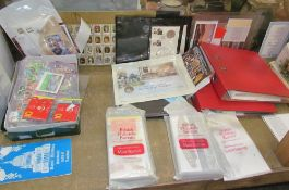 A collection of mint stamps together with stamp albums,