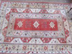 A room size orange ground rug with an orange centre,