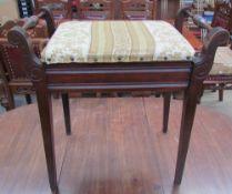 An Edwardian mahogany piano stool on square tapering legs