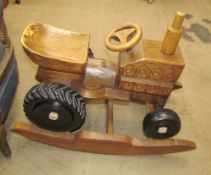 A child's carved wooden rocking tractor