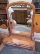 A Victorian mahogany toilet mirror with a domed mirror and two base drawers