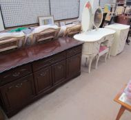 A reproduction mahogany sideboard together with a cream dressing table,