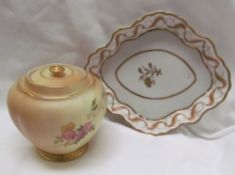 A Royal Worcester porcelain lobed jar and cover decorated worth flowers and leaves together with a