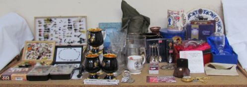 "A collection of fishing flies and fishing reels, together with ""The One That Got Away"" money box,"