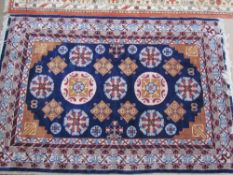 A blue group rug with multiple medallion and flowers