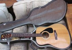 A Yamaha FG-332 six string acoustic guitar,