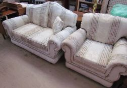 A two seater settee with matching armchair
