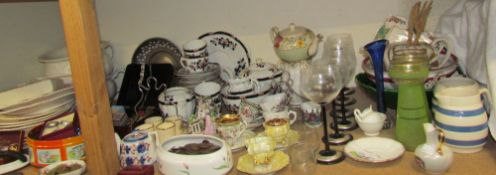 Decorative cups and saucers together with part tea sets, tulip vases, drinking glasses,
